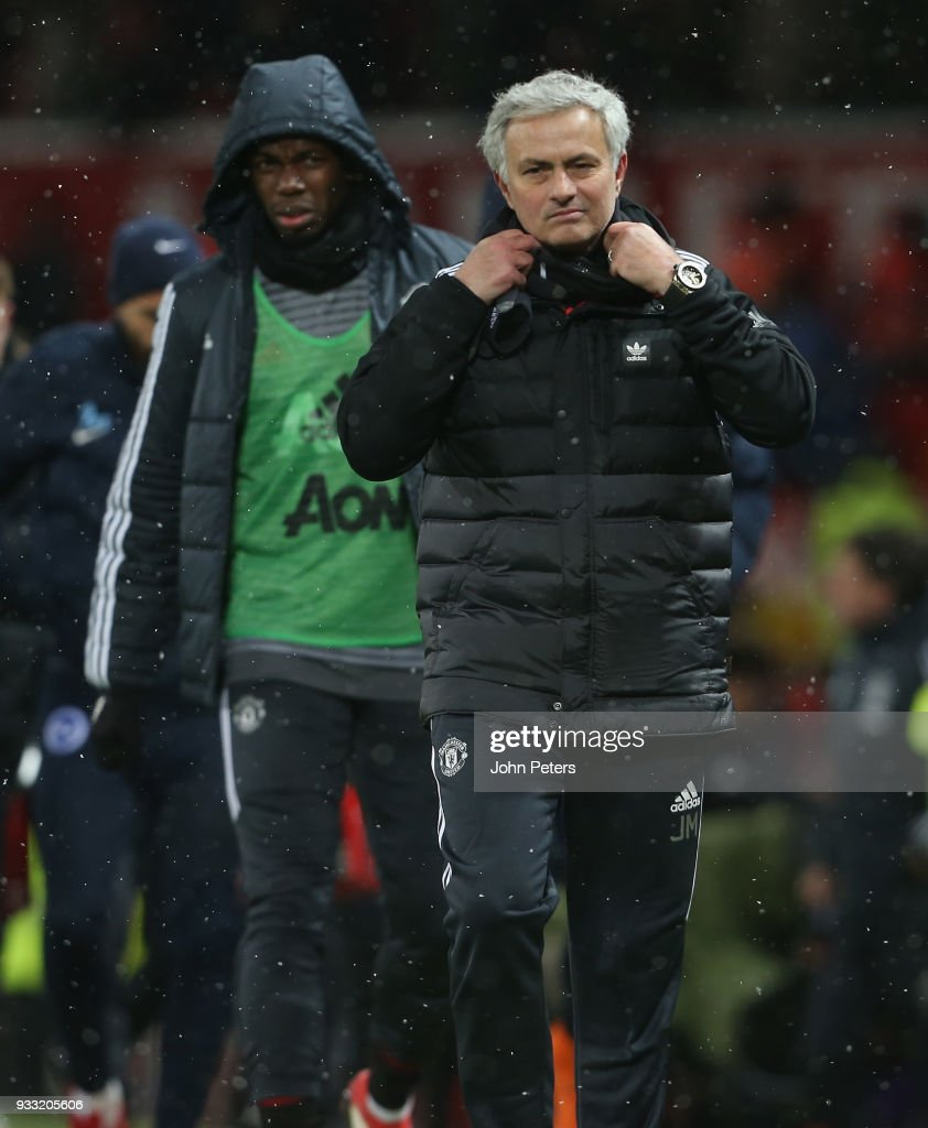 Manager Jose Mourinho of Manchester United walks off after the Emirates FA Cup Quarter Final match between Manchester United and Brighton & Hove Albion at Old Trafford on March 17, 2018 in Manchester, England.