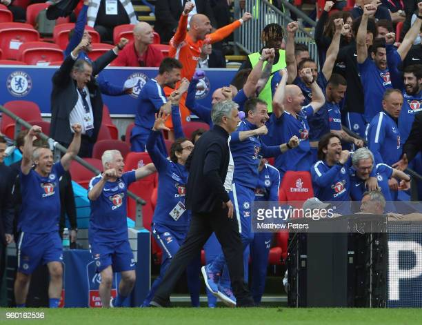 Manager Jose Mourinho of Manchester United walks over to congratulate Manager Antonio Conte of Chelsea after the Emirates FA Cup Final match between...