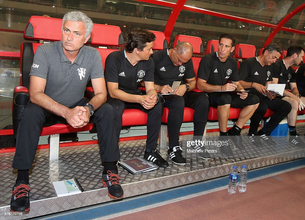 Manager Jose Mourinho of Manchester United watch from the dugout during the pre-season friendly match between Manchester United and Borussia Dortmund at Shanghai Stadium on July 22, 2016 in Shanghai, China.