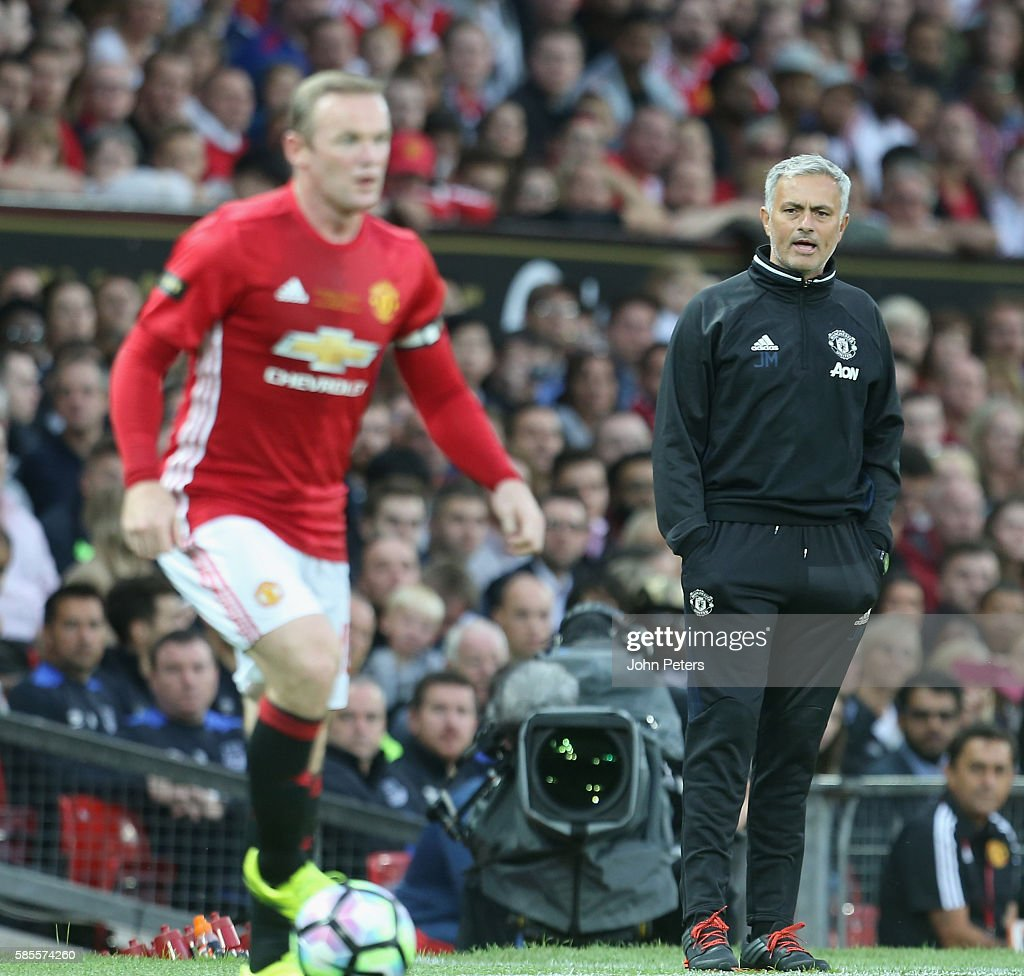 Manager Jose Mourinho of Manchester United watches from the touchline during the Wayne Rooney Testimonial match between Manchester United and Everton at Old Trafford on August 3, 2016 in Manchester, England.