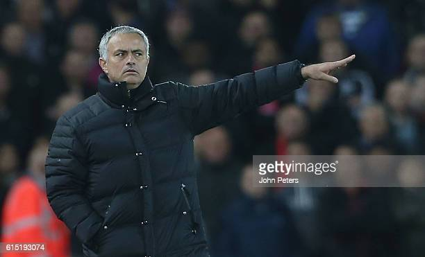 Manager Jose Mourinho of Manchester United watches from the touchline during the Premier League match between Liverpool and Manchester United at...