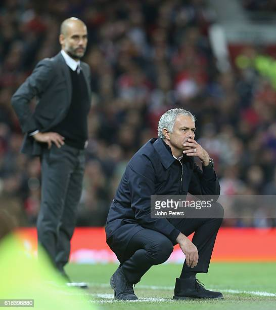 Manager Jose Mourinho of Manchester United watches from the touchline the EFL Cup Fourth Round match between Manchester United and Manchester City at...