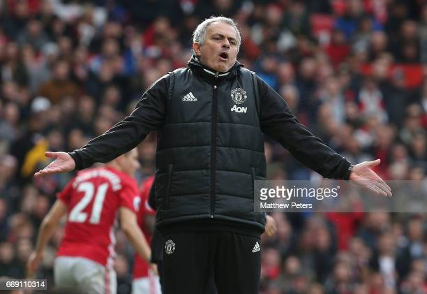 Manager Jose Mourinho of Manchester United watches from the touchline during the Premier League match between Manchester United and Chelsea at Old...