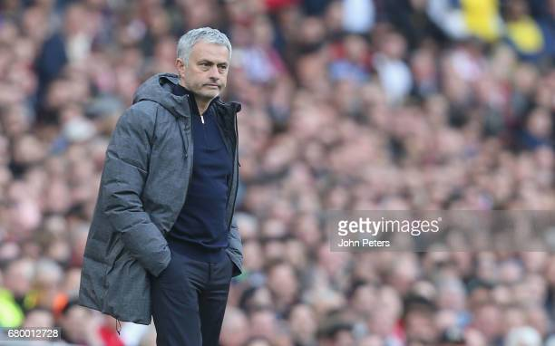 Manager Jose Mourinho of Manchester United watches from the touchline during the Premier League match between Manchester United and Arsenal at...