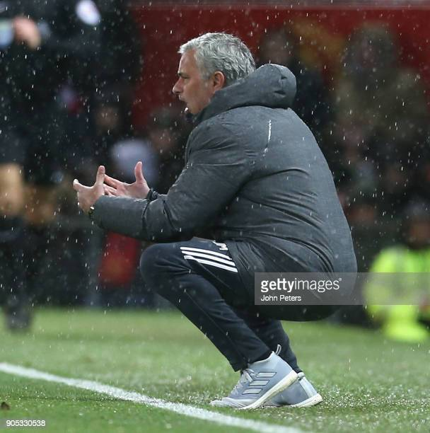 Manager Jose Mourinho of Manchester United watches from the touchline during the Premier League match between Manchester United and Stoke City at Old...