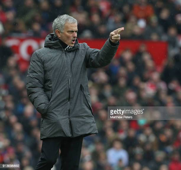 Manager Jose Mourinho of Manchester United watches from the touchline during the Premier League match between Manchester United and Huddersfield Town...