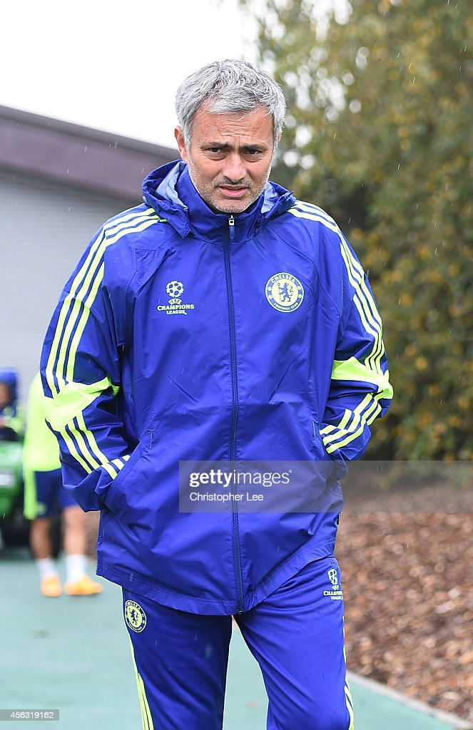 Manager Jose Mourinho walks out onto the training pitch during the Chelsea Training Session at Chelsea Training Ground on September 29, 2014 in Cobham, England.