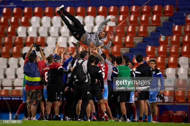 Manager Juanfran Garcia of CD Lugo is thrown by the air at the end of the La Liga Smartbank match between CD Lugo and CD Mirandes at Estadio Angel...