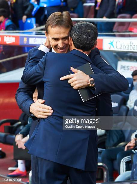 Manager Julen Lopetgui of Real Madrid embraces Manager Ernesto Valverde of Barcelona prior to the La Liga match between FC Barcelona and Real Madrid...