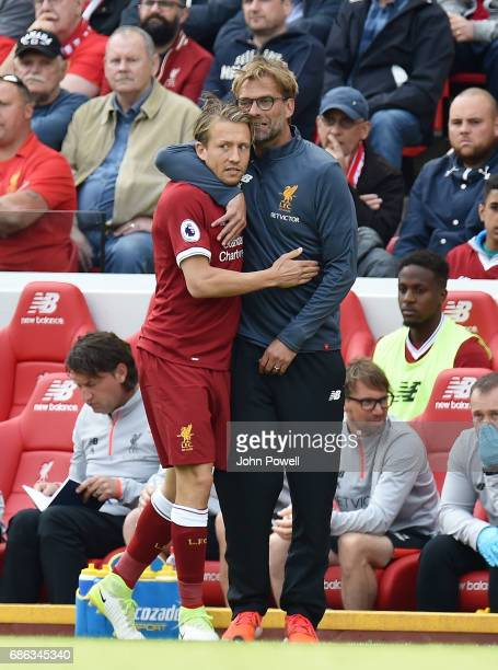 Manager Jurgen Klopp gives Lucas Leiva of Liverpool a hug during the Premier League match between Liverpool FC and Middlesbrough FC at Anfield on May...