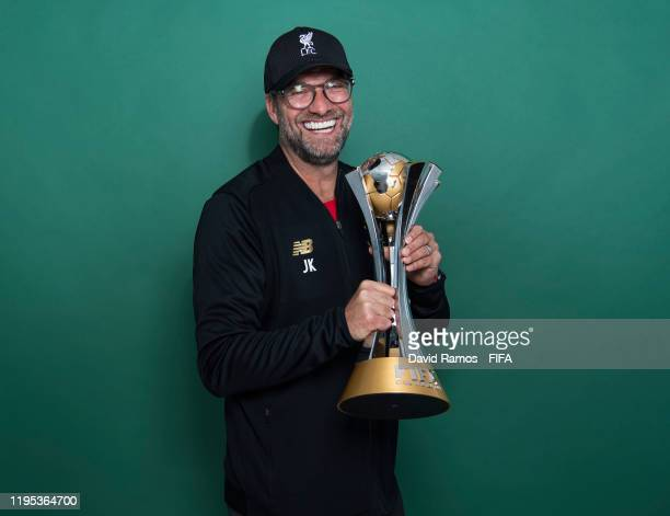 Manager Jurgen Klopp of Liverpool poses with the Club World Cup trophy after the FIFA Club World Cup Qatar 2019 Final match between Liverpool and CR...