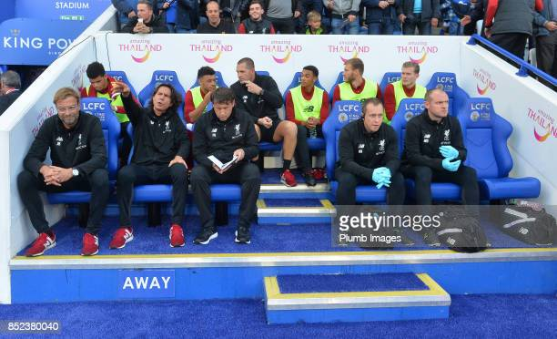 Manager Jurgen Klopp of Liverpool sits in the away team dugout at King Power Stadium ahead of the Premier League match between Leicester City and...