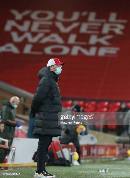 Manager Jurgen Klopp of Liverpool watches from the touchline during the Premier League match between Liverpool and Manchester United at Anfield on...