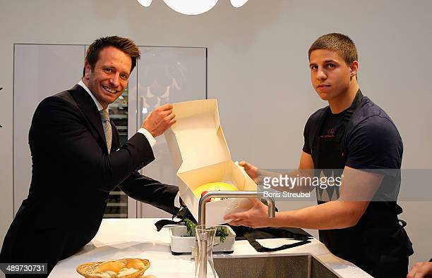 Manager Kalle Sauerland hands over a birthday cake to Tyron Zeuge during the press conference ahead of the WBA Light Heavyweight World Championship...