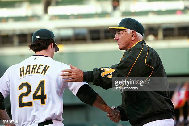 Manager Ken Macha encourages Danny Haren of the Oakland Athletics during the game with the Toronto Blue Jays at McAfee Coliseum on April 11 2005 in...