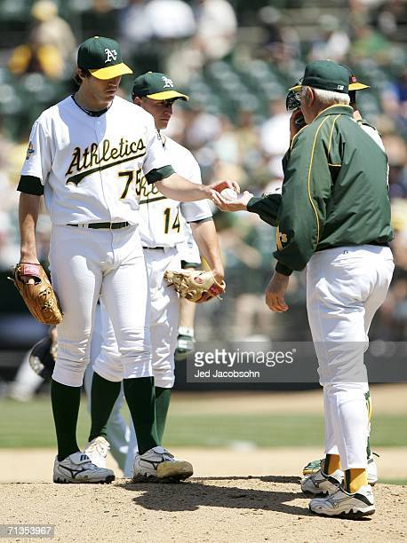 Manager Ken Macha of the Oakland Athletics pulls starting pitcher Barry Zito in the 9th inning of the game against the Arizona Diamondbacks at McAfee...