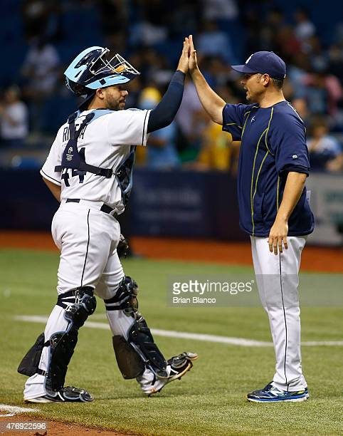 Manager Kevin Cash of the Tampa Bay Rays celebrates with catcher Rene Rivera following the Rays' 75 win over the Chicago White Sox on June 12 2015 at...