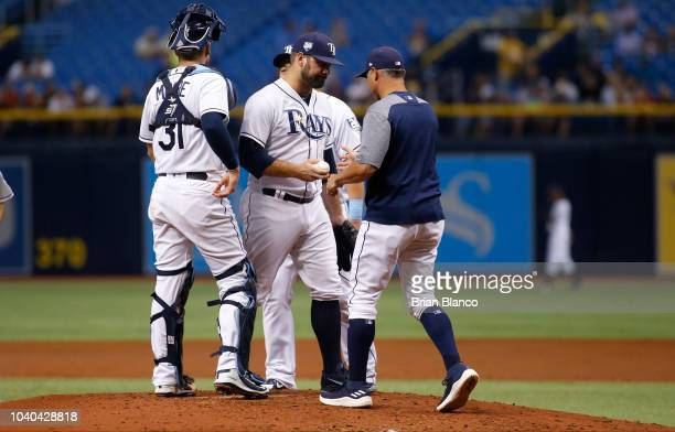 Manager Kevin Cash of the Tampa Bay Rays takes pitcher Andrew Kittredge out of the game in the third inning against the New York Yankees on September...