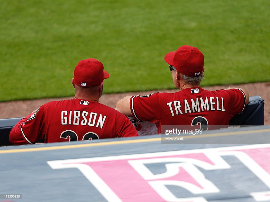 Manager Kirk Gibson #23 and bench coach Alan Trammell #3 of the Arizona Diamondbacks watch the action on the field from the dugout during the game against the Atlanta Braves at Turner Field on June 30, 2013 in Atlanta, Georgia.