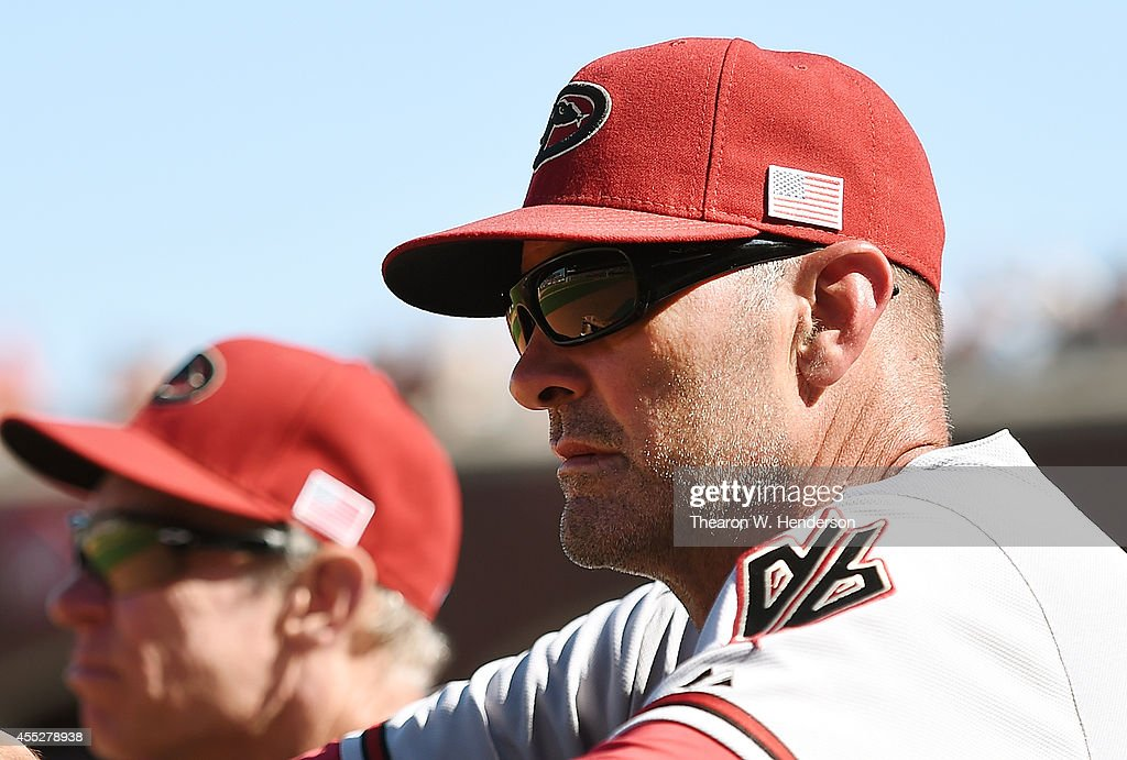 Manager Kirk Gibson #23 of the Arizona Diamondbacks looks on from the dugout against the San Francisco Giants in the top of the eighth inning at AT&T Park on September 11, 2014 in San Francisco, California.