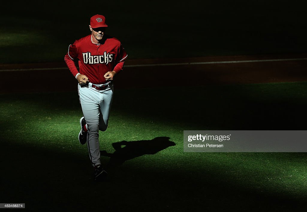 Manager Kirk Gibson #23 of the Arizona Diamondbacks walks off the field during the tenth inning of the MLB game against the Colorado Rockies at Chase Field on August 10, 2014 in Phoenix, Arizona. The Rockies defeated the Diamondbacks 5-3 in 10 innings.
