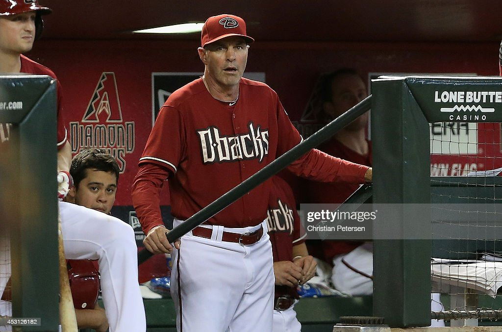 Manager Kirk Gibson #23 of the Arizona Diamondbacks watches from the dugout during the MLB game against the Arizona Diamondbacks at Chase Field on August 3, 2014 in Phoenix, Arizona.