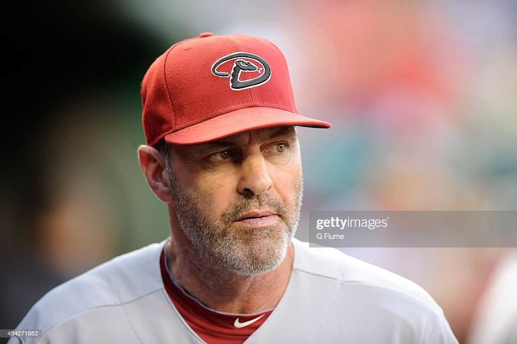 Manager Kirk Gibson #23 of the Arizona Diamondbacks watches the game against the Washington Nationals at Nationals Park on August 19, 2014 in Washington, DC.