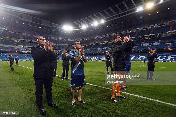 Manager Klaus Allofs and players of Wolfsburg applaud to the fans after the UEFA Champions league Quarter Final Second Leg match between Real Madrid...