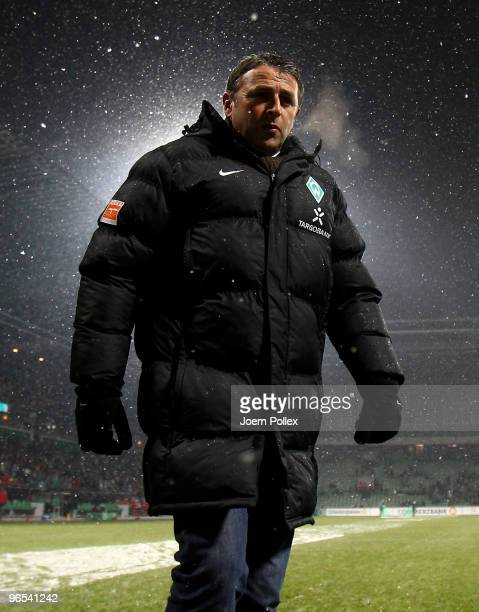 Manager Klaus Allofs of Bremen looks on prior to the DFB Cup quarter final match between SV Werder Bremen and 1899 Hoffenheim at Weser Stadium on...