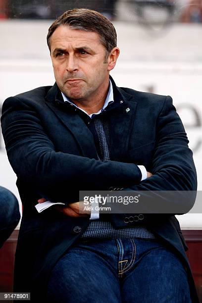 Manager Klaus Allofs of Bremen waits for the start of the Bundesliga match between VfB Stuttgart and SV Werder Bremen at the MercedesBenz Arena on...