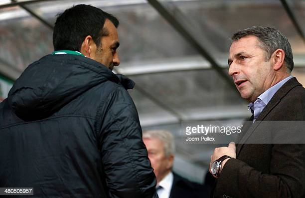 Manager Klaus Allofs of Wolfsburg and Robin Dutt head coach of Bremen chat prior to the Bundesliga match between Werder Bremen and VfL Wolfsburg at...