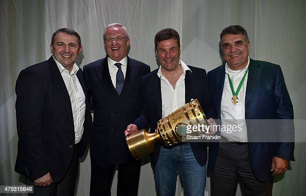 Manager Klaus Allofs of Wolfsburg executive chairman of the directors of Volkswagen Martin Winterkorn head coach of VfL Wolfsburg Dieter Hecking and...
