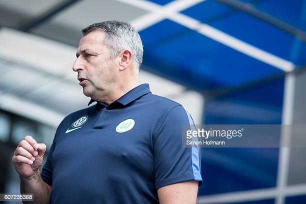 Manager Klaus Allofs of Wolfsburg looks on prior to the Bundesliga match between TSG 1899 Hoffenheim and VfL Wolfsburg at Wirsol RheinNeckarArena on...