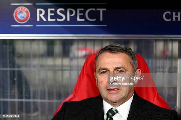 Manager Klaus Allofs of Wolfsburg sits on the bench during the UEFA Champions League Group B match between PSV Eindhoven and VfL Wolfsburg at Philips...