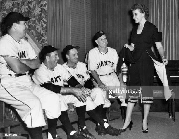 Manager Leo Durocher and his coaches of the New York Giants take time out from their series fingernail biting to admire an outfit worn by Laraine...