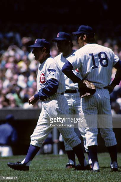 Manager Leo Durocher of the Chicago Cubs heads towards home plate and the umpire as Thirdbaseman Ron Santo and secondbaseman Glenn Beckert watch...