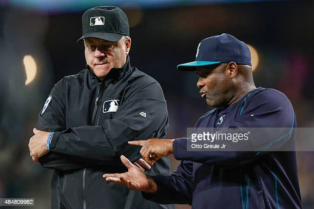 Manager Lloyd McClendon of the Seattle Mariners converses with first base umpire Gary Cederstrom in the eighth inning against the Chicago White Sox...