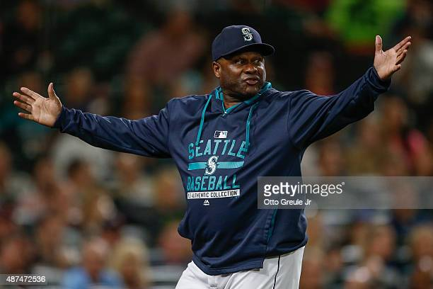 Manager Lloyd McClendon of the Seattle Mariners gestures as he asks for a replay review after Robinson Chirinos of the Texas Rangers was hit by a...