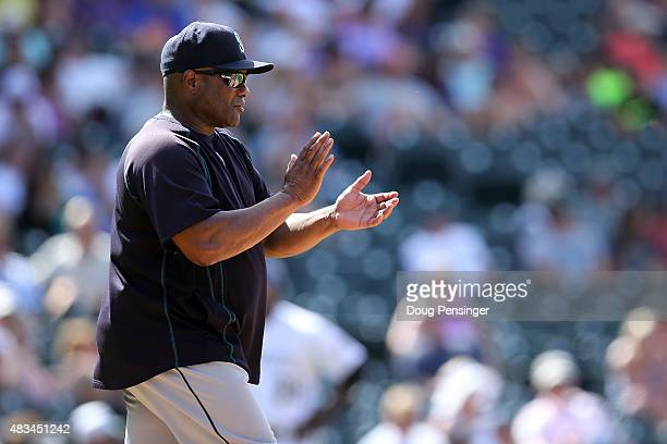 Manager Lloyd McClendon of the Seattle Mariners heads to the mound to make a pitching change against the Colorado Rockies during interleague play at...