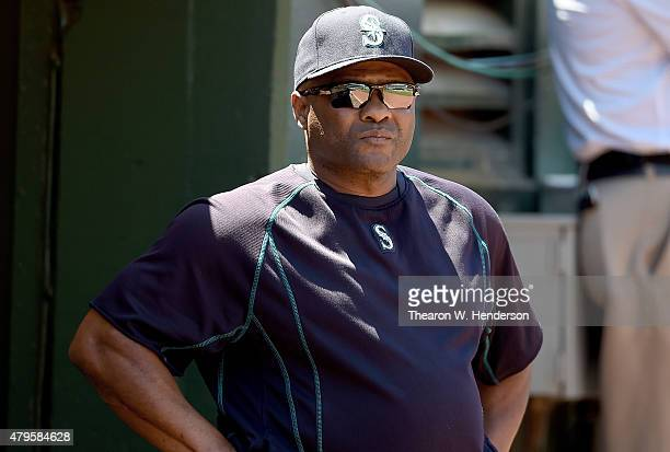 Manager Lloyd McClendon of the Seattle Mariners looks on from the dugout against the Oakland Athletics in the top of the six inning at Oco Coliseum...