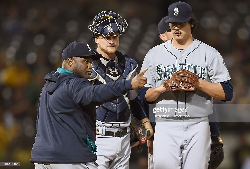 Manager Lloyd McClendon #21 of the Seattle Mariners signals the bullpen to make a pitching change, replacing starting pitcher Edgar Olmos #49 against the Oakland Athletics in the bottom of the second inning at O.co Coliseum on September 4, 2015 in Oakland, California.
