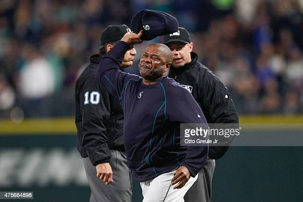 Manager Lloyd McClendon of the Seattle Mariners throws his hat after being ejected by first base umpire Will Little in the third inning against the...