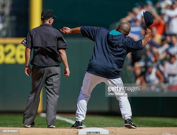 Manager Lloyd McClendon of the Seattle Mariners throws his hat into right field after being ejected in the seventh inning by first base umpire Lance...