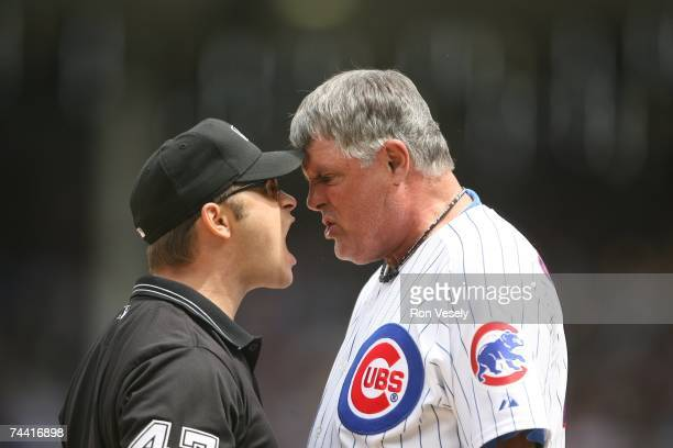 Manager Lou Piniella of the Chicago Cubs argues face to face with third base umpire Mark Wegner after Wegner ejected Piniella during the eigth inning...
