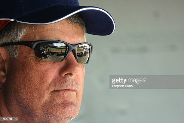 Manager Lou Piniella of the Chicago Cubs sits in the dugout before the game with the Los Angels of Anaheim on March 1 2008 at Tempe Diablo Stadium in...