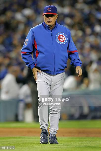 Manager Lou Piniella of the Chicago Cubs walks out to the mound to talk with pitcher Rich Harden while taking on the Los Angeles Dodgers in Game...