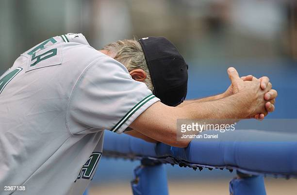 Manager Lou Piniella of the Tampa Bay Devil Rays has trouble watching as his team get only three hits against pitcher Bartolo Colon of the Chicago...