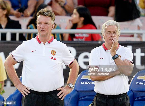 Manager Louis van Gaal and chief opposition scout Marcel Bout of Manchester United follow team warm ups during the pre-season friendly match between...