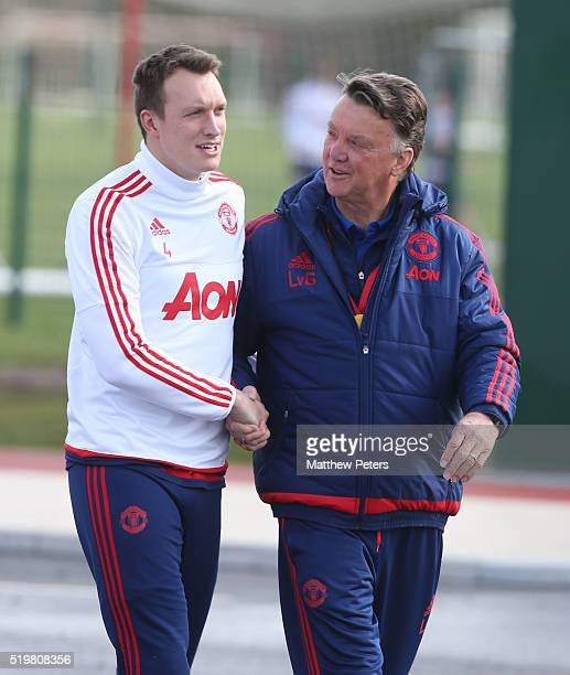 Manager Louis van Gaal and Phil Jones of Manchester United in action during a first team training session at Aon Training Complex on April 8 2016 in...