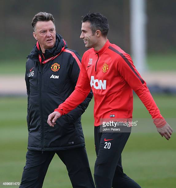 Manager Louis van Gaal and Robin van Persie of Manchester United in action during a first team training session at Aon Training Complex on November...